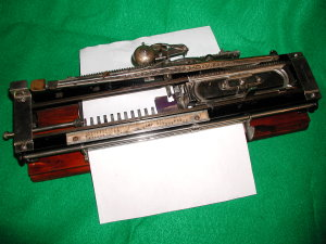 Alexis typewriter with paper inserted